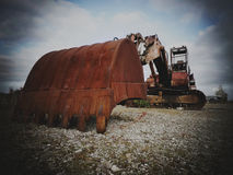 360 digger in a field rusty 3 Stock Images