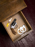 38 Revolver in Desk Drawer with Handcuffs Stock Photos