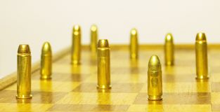 .38 special versus 9 luger. Gunfight on the chessboard .38 special versus 9 mm luger Royalty Free Stock Photo