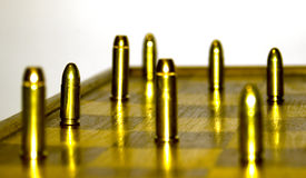 .38 special versus 9 luger. Gunfight on the chessboard .38 special versus 9 mm luger Stock Photo