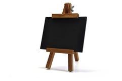 3d黑板画架查出您的文本 图库摄影