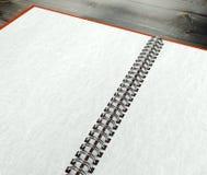 3d abren el cuaderno en blanco en textura del papel del escritorio Foto de archivo