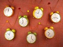 3D Alarm Clocks. Vintage Alarm Clocks on Orange Background Royalty Free Stock Photos