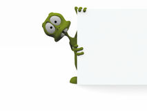 3D alien with a blank sign. 3D cartoon alien with a blank sign Stock Photography