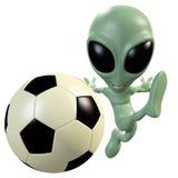3D alien kicking a ball Stock Photo