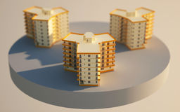 3d apartment blocks. 3 apartment blocks isolated on a 3d cylindrical ground. block in front is sharp, the other 2 blocks are blurred. Depth of field suggest that Royalty Free Stock Photo