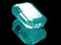 3d Aquamarine. A render of a 3d Aquamarine gem isolated on a black background with reflection Royalty Free Stock Image