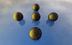 3D Balls on the water. 3D Balls on the blue water with reflection of sun and clouds Royalty Free Stock Photo