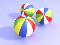 3D beach Balls. On blue background Royalty Free Stock Photography
