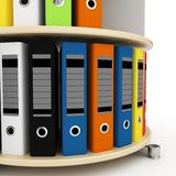 3d binders on a shelf. Isolated on white Stock Photo