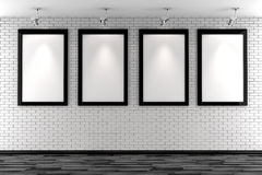 3d blank frames on a white brick wall Stock Photos