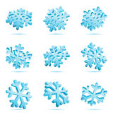 3D Blue Snowflakes. Three dimensional illustrations of different blue snowflakes tilted at different angles. Isolated Stock Photo