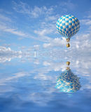 3d blue-white checker balloon. In the sky and reflection in water Stock Images