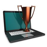 3d bronze cup on a laptop. Isolated on white Stock Photography