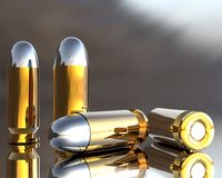 3D bullets. Bright 3D golden and silver bullets in hdri Royalty Free Stock Image