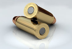 3D Bullets. Two brass chrome cartridges lying across Royalty Free Stock Photography