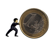 3d business man push a euro coin. A 3d business man push a euro coin Royalty Free Stock Photo