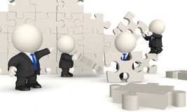3D business men - puzzle assembling Stock Photos