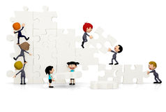 3D Business team arranging a puzzle Royalty Free Stock Photography