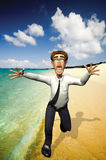 3d businessman holiday. The businessman is in holiday, so he is running on the beach Royalty Free Stock Photo
