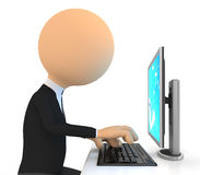 3d character Working on computer. Stock Image