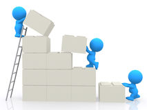3D characters building a wall Royalty Free Stock Photos