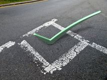 3d check mark on pavement Stock Image