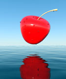3D cherry. That falls into the water Royalty Free Stock Image
