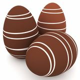 3d chocolate eggs with white stripes Stock Photos