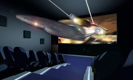3D Cinema. A shuttle gets out of the screen as we can see from a cinema seat Royalty Free Stock Image