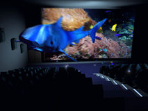 3D Cinema. In a cinema, a  3D documentary about marine life gives the impression that a shark is taking out of the screen Royalty Free Stock Photos