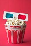 3D cinema. 3D glasses on top of a bucket of popcorn - 3D cinema concept, shallow dof Royalty Free Stock Photo
