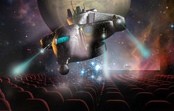 3D Cinema. In a cinema, a  3D science fiction movie gives the impression that a spaceship comes   out of the screen Royalty Free Stock Photography