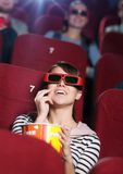 At the 3D cinema. Smiling women at the 3D cinema royalty free stock photography