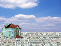 A 3D concept house on money and blue sky background Stock Photo