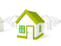 3d different house with green roof standing out from crowd. Stock Photo