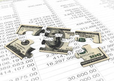 3d dollar puzzle peaces. On the background of spreadsheet Stock Photography