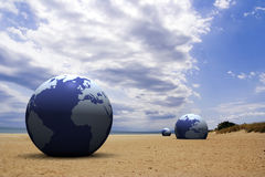 3d earth on the beach Stock Photos