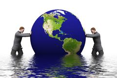 3d earth and man. Two businessman is pushing the 3d world against each other Royalty Free Stock Photos