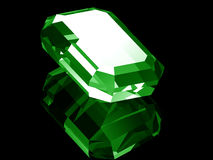 3d Emerald. A render of a 3d Emerald isolated on a black background with reflection Royalty Free Stock Photography