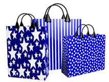 3D Festive Blue Shopping Bags. Three 3D shopping bags in festive blue prints Royalty Free Stock Images