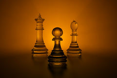 3d glass chess. Three glass chess pieces: pawn, bishop and queen illuminated by light Stock Images