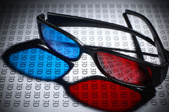 3D glasses. Plastic 3D glasses on text stock photo