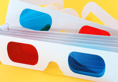 3D glasses. 3d movie glasses on yellow background royalty free stock photography