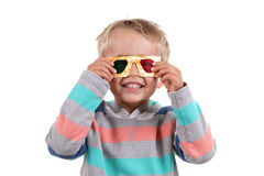 3D glasses. Child wearing 3d glasses isolated on white stock photos