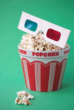 3D glasses & a bucket of popcorn Royalty Free Stock Photography