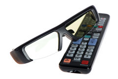 3d glasses and tv remote control. On white background Stock Image