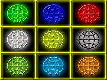 3D globes. A collection or set of variously colored globes on a black background Stock Images