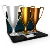 3d gold silver bronze cups on laptop Royalty Free Stock Images