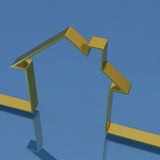 3D golden house. On blue background Stock Photography